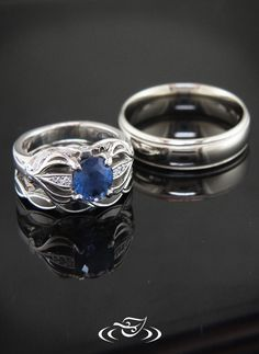 Wedding set with beautiful blue sapphire with curling pierced design.