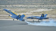 160320-N-NI474-112 LANCASTER, Calif. (Mar. 20, 2016) U.S. Navy Flight Demonstration Squadron, the Blue Angels, Lead Solo Pilot Lt. Ryan Chamberlain takes off along side Opposing Solo Pilot Capt. Jeff Kuss during the Los Angeles County Air Show, Mar. 20, 2016. The Blue Angels are celebrating its 70th anniversary and are scheduled to perform 65 demonstrations at 34 locations across the U.S. in 2016. (U.S. Navy photo by Mass Communication Specialist 2nd Class Daniel M. Young/Released)