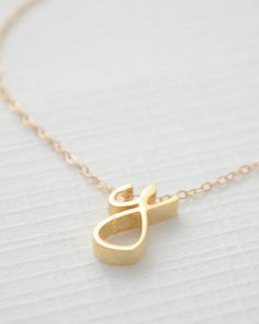 Cursive Lowercase Letter Necklace in silver, gold and rose gold by Olive Yew. A beautiful way to personalize your layering necklaces.