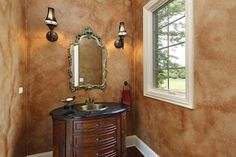Main floor lavatory with wooden vanity, small frame window and marble painting technique on the walls