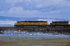 World's largest diesel locomotive    In very much spring-like weather for Wyoming, with threatening clouds and a dusting of snow, an eastbound Union Pacific freight approaches Laramie in April 1984.