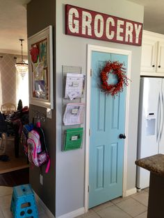 Painted pantry door behr ocean kiss, walls dolphin fin . Grocery sign hobby lobby, wreath, baskets, bulletin board and hooks HomeGoods :)