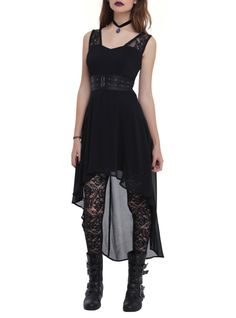 Black chiffon hi-lo dress from Royal Bones with a faux leather waistband, grommet and buckle detail and lace shoulder straps. Back zipper closure.