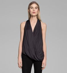 May Must Haves!: I can't get enough of this gorgeous draped Helmut Lang Glassy top ($195). It would look just as amazing under a blazer for work as it would later into the evening, worn alone with a pair of printed shorts and heels. — Chi Diem Chau