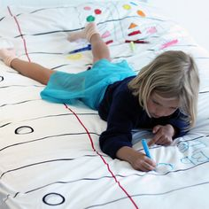 Comforter you can doodle on. Washes completely clean. This is really cool!