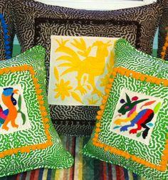 Mexican Textiles + pom pom fringe = Fun pillows! www.galeriebonheur.com
