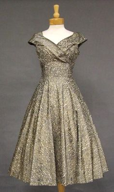 I like the bodice.  Rustling Grey & Ivory Acetate 1950's Cocktail Dress w/ Gold Paint VINTAGEOUS VINTAGE CLOTHING