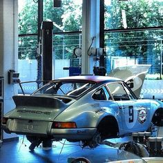A 1973 Porsche 911 RSR in the Porsche Classic workshop facilities. Wish it was mine …