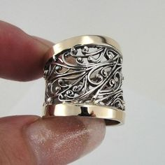Stunning NEW silver & gold ring.  The ring is made of sterling silver with two polished 9k Yellow Gold bars over 20 mm wide very rich pattern filigree