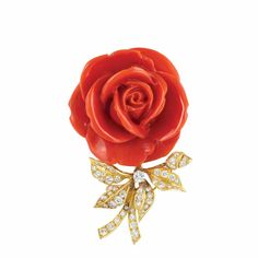 Gold, Carved Coral and Diamond Flower Clip-Brooch, Boucheron, Paris  18 kt., topped by one carved coral flower approximately 37.0 x 37.2 mm., supported by a gold stem and leaves centering one round diamond approximately .20 ct., set with 50 round and 2 single-cut diamonds approximately 1.50 cts., signed Boucheron.