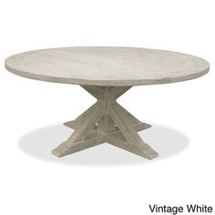 Reclaimed wood will appear cracked and imperfect Bring classic appeal into your kitchen with this wooden dining table made of gorgeous reclaimed wood. This round dining table's 2-inch thick tabletop i