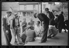 Coal miners card gambling Saturday afternoon on porch of company store, Chaplin, West Virginia. 1938.