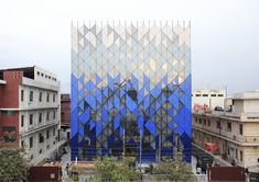 """Completed in 2018 in Noida, India. Images by Daud Malik, Amit Khanna. Tessellate (verb) """"tocover (a plane surface) by repeated use of a single shape, without gaps or overlapping."""" The persistence of zoned industrial. Mall Facade, Retail Facade, Facade Architecture, Amazing Architecture, Facade Design, Exterior Design, Photo D'architecture, Facade Pattern, Future Buildings"""