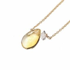 """CITRINE HERKIMER NECKLACE by JULIA SZENDREI. 17"""" total length, 14k gold filled. Citrine is best known as the joy stone. It's light hearted, playful color tones invite happy emotions and translate a sense of freedom and youthful glow. A great reminder that happiness and beauty surrounds you and paired here with a tiny Herkimer Diamond crystal it adds clarity and a beautiful satellite gemstone to pair up together. Each citrine will be one of a kind. Shop Now ww.juliaszendrei.com"""