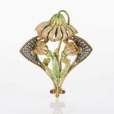 Art Nouveau Gold and Enamel Flower Brooch A French Art Nouveau 18 karat gold brooch with diamonds and enamel. The brooch depicts 3 blush and green enamel flowers that are accented by 50 rose-cut diamonds with an approximate total weight of .30 carat. The brooch has a detachable pin back and can also be worn as a pendant. 1900