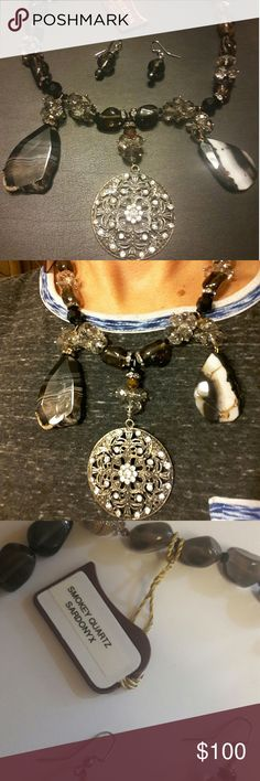Stunning necklace Beaded necklace with Smokey quartz and a beautiful medallion. Comes with earrings to match! Great statement piece! Made in a bead store Jewelry Necklaces