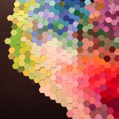 Colorful tiny hexagons cut out of paint chips by @josielewisart •