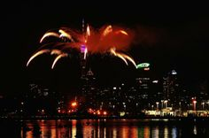 """""""Celebrating New Year 2014-Fireworks are let off from the Auckland Sky Tower to celebrate the new year"""""""
