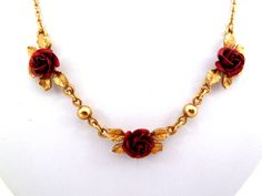 Gold tone chain necklace with red enamel roses.