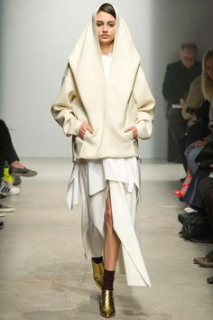 5. Maison Rabih Kayrouz | Fall 2014 Ready-to-Wear Collection | Style.com, This hooded coat resembles the bonnet represented in the example.