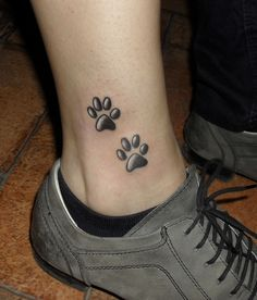 Cat tattoos have also caught a great of attention of late as a coveted animal to mark our body with! Here are some amazing cat tattoo designs for women to pick from. Cat Paw Tattoos, Animal Tattoos, Body Art Tattoos, Small Tattoos, Tatoos, Tattoo Cat, Print Tattoos, Tattoo Girls, Ankle Tattoo For Girl