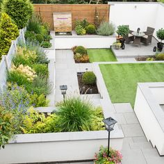 Struggling to cope with a sloping, muddy lawn and overgrown borders, the owners transformed their hilly garden into a space that's a pleasure, not a chore
