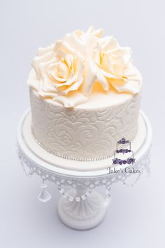 Design based on Oriana's Ivory rose wedding cake made in October 2012 - made as a birthday cake this time cut can be an engagement cake or wedding cake design