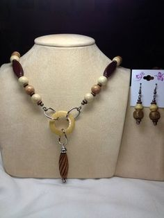 Chunky shades of brown wooden beads strung with flexable beading wire.  PURCHASE: https://admin.shoptab.net/linkbacks/203261267   Handmade Jewelry by Casual Elegant Fashions
