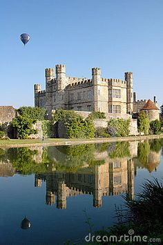 Hot air balloon rising over Leeds Castle in Kent, England