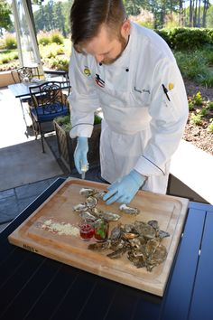 Just shuck it! Believe it or not, there's a technique for getting to all that #oyster goodness! Chef de Cuisine Murray Healy cracks open a few on the Fairview Dining Room terrace during ‪#‎NationalSeafoodMonth‬.