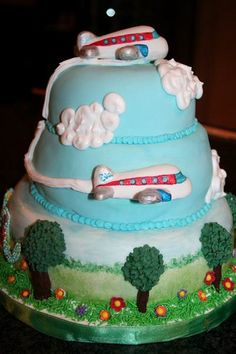 Airplane Cake, s likes it, the layers are really cool, its not just a plane on the runway