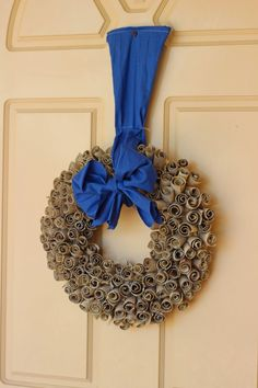 Wreath made from toilet rolls and scrap cardboard/newspaper and material. Very nice.