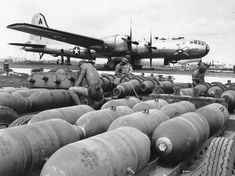 November 1944: Ground crew members prepare bombs to be loaded into the racks of the waiting B-29 Superforts, at a U.S. airbase on Saipan, in the Mariana Islands. (AP Photo) #
