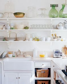 Kitchen shelving holds dinnerware.
