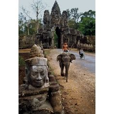 """""""Angkor Wat in Cambodia, the largest religious complex in the world, is famed for its temples, statues and monks, and is a World Heritage Site."""""""