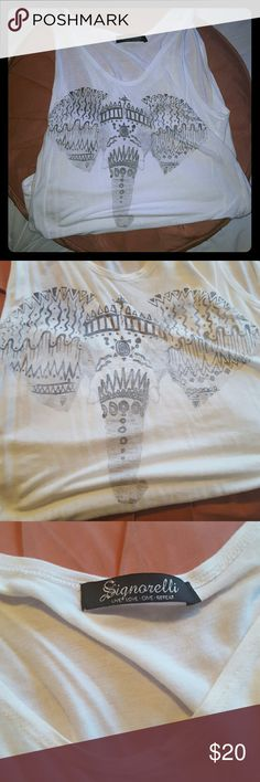 Elephant White Tank This tank is perfect for summer festivals!  Who doesn't love elephants!?  Super soft and comfortable!  There is a small stain on lower right side but barely noticable! Otherwise in perfect condition !  Size small and true to size  Thanks for shopping Signorelli Tops Tank Tops