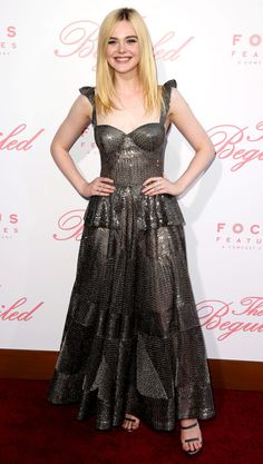 Elle Fanning wears a sequined chrome Naeem Khan gown, Tamara Mellon heels and over $150,000 worth of Tiffany & Co. diamond jewelry to the premiere of The Beguiled.