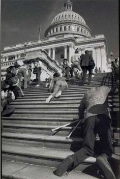 """""""Disability activists abandon their wheelchairs and mobility devices and crawl up the 83 stone steps of the U.S. Capital Building demanding the passage of the American with Disability Act, March 12, 1990."""""""