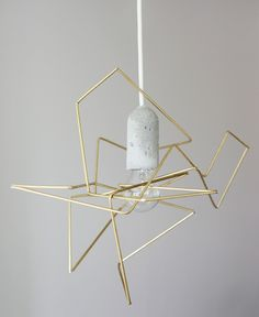 DIY chic lamp by Riikka Kantinkoski:  using 4 thin and hollow metallic tubes, tie twine through them, and start folding freely to create geometric shape.