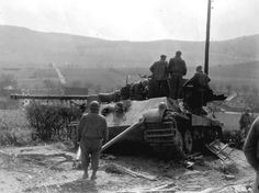 Tank photo.  Captured King tiger tank 2 porsche turret, July 1944 Chateu de Canteloup.