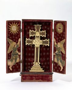 Cross reliquary      Place of origin:    Spain (made)      Date:    16th century (made)      Artist/Maker:    Unknown (production)      Materials and Techniques:      Wood mounted in silver gilt in wooden case lined with embroidered velvet  - V & A