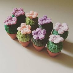 "This pattern shows how to make an itty bitty cactus with a flower on top, ""potted"" in a 2"" terracotta pot."