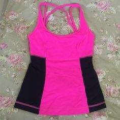 Lululemon tank Lightly used condition, only worn once or twice! Pink with dark purple panels! lululemon athletica Tops
