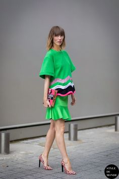 book clutch with bright green outfit