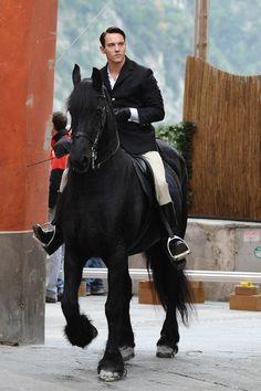 Jonathan Rhys Meyers on a black stallion..very appropriate.  : )