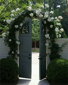 Arches are beautiful features to any garden. If you are feeling very creative why not make a garden gate out of your arch? Although with this you must make sure to maintain the flowering around the arch all year round, however if you succeed in doing this Garden Entrance, Garden Doors, Entrance Gates, Garden Gates, Arco Floral, Smith Gardens, Arched Doors, Fence Gate, Fencing