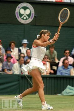 Chris Evert's awesome backhand, wearing vintage Ellesse with ruffled tennis shorts