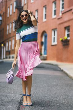 August 2016 — The actress often steps out in neutrals, but she's can pull off saturated hues too. These pink pleats go perfectly with a striped T. BUY NOW