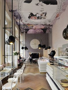 goodness! look at that ceiling! and that floor!  Lolita coffeehouse by Trije arhitekti and Kaval Group