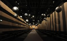 Fendi: The Fondazione Arnaldo Pomodoro in Milan served as the show space for Fendi. The playfully surreal set's walls were lined with geometric stripes, while large silver balloons hung above the catwalk